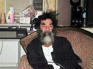 Deposed Iraqi President Saddam Hussein sits on a couch shortly after his capture by U.S. forces in a farm house outside Tikrit, Iraq, 14 December 2003. )Photo courtesy of www.military.com) dpa